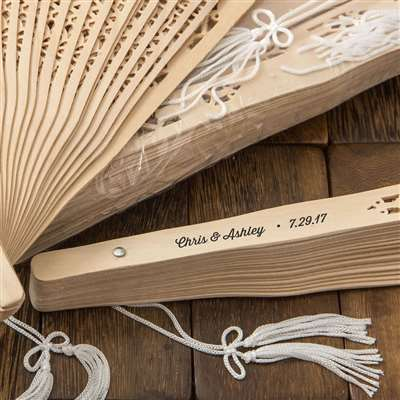 Intricately carved personalized Sandalwood fan favors